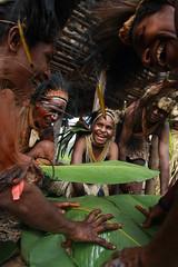 Kosua Tribespeople Prepare Mumu