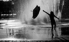 Flying Umbrella (Olderhvit) Tags: street summer blackandwhite fountain umbrella play gothenburg streetphotography streetphoto goteborg streetpics gatufoto 1040059 framingthestreet olderhvit