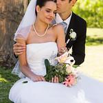Groom kissing his beautiful bride at park thumbnail
