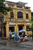 _DSC0631 (lnewman333) Tags: hoian vietnam centralvietnam sea southeastasia asia oldquarter architecture building umbrella bike bicycle heat conicalhat rickshaw wires electricalwires