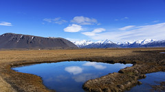 there are clouds in my pond (lunaryuna) Tags: iceland southeasticeland onroutetodjupivogur leavingthesouth landscape panoramicviews sky clouds cloudscape ponds bog mountains mountainrange thelightfantastic spring season seasonalchange lunaryuna reflections seeingdouble ngc