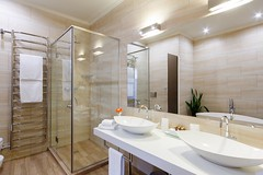 bathroom of the hotel rooms, with a shower and a few washbasins (wanouwa) Tags: bathroom shower bath number hotel big cozy interior wallpaper corporate room design house modern floor lamp walls apartments elegant relax lightcoloured beautiful mirrors sinks bathrobes towels cosmetics plumbing heatedtowelrail tile ukraine