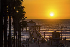 Sunset above Manhattan Beach (isaac.borrego) Tags: uploadedviaflickrqcom sand beach water ocean clouds sky pier pacificocean manhattanbeach losangeles california canonrebelt4i