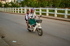 Schoolgirls in uniform on scooter, Battambang, Cambodia (Alex_Saurel) Tags: moto type culture horizontal orientation asia photoreport road lifescene day reportage clothes scènedevie travel fille people photospecs action schoolgirl imagetype girl fullframe cambodge lifestyles photojournalism uniform archicategory motorbike scans pleinformat stockcategories time photoreportage transportation urbanisme sony50mmf14sal50f14