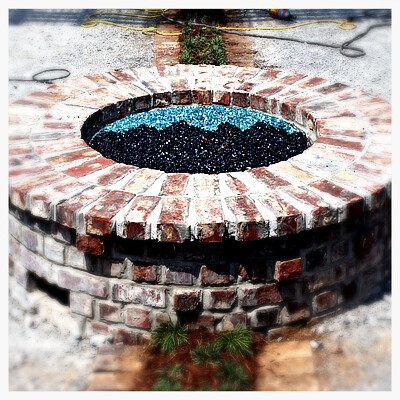 Custom 150,000 btu Fire Pit in Chattanooga (Notice the Crash Pad's logo in the glass)