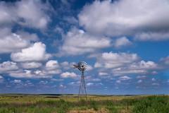Windmill (explore) (unknown quantity) Tags: sky windmill clouds fence shadows cattle horizon weathered shortgrassprairie cloudsstormssunsetssunrises