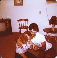 Wendy's first cigarette, 1976 (STUDIOZ7) Tags: woman man guy girl television tv furniture cigarette smoking livingroom 70s lightup lighter mustache 1970s smoker seventies zippo lightingup