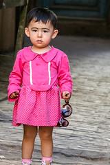 A little girl wearing tradithional eyeblow make-up, Kashgar old city (inchiki tour) Tags: travel people girl alley snapshot uighur xinjiang silkroad kashgar  uyghur traveling centralasia  kashi    osma 2015