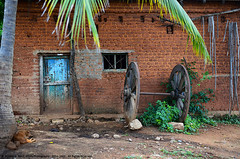 THE OLD HOUSE (GOPAN G. NAIR [ GOPS Photography ]) Tags: old house brick texture wheel wall photography day lazy cart gops gopan gopsorg gopangnair gopsphotography