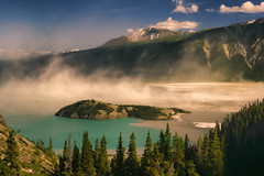 Dust storm at Kluane lake (wimvandemeerendonk, at the moment in Canada enjoyi) Tags: blue trees wild mountain lake canada color reflection tree green nature water rock contrast forest landscape outdoors nationalpark rocks colours bright outdoor sony yukon ripples goldenhour monumental mountainscape kluane kluanenationalpark flickrelite theperfectphotographer tachäldhäl wimvandem