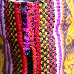 re-stitched (overthemoon) Tags: square macromondays redux footwear inkkas seam fabric woven boot stitch repair restitched favoritethemeoftheyear closeup macro shoe backseam mended sewn red yellow black magenta frayed effiloché