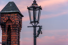 Un des 300 nains de Wroclaw (Voyages Lambert) Tags: wroclaw morning cloudscape goldcolored lantern brick oldtown streetlight love yellow red pinkcolor blue poland easterneurope sunlight sunset sunrisedawn cloudsky sun sky river electriclamp ostrowtumski dwarf