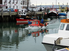 Bringing home the catch.... on yet another grey day... 3pm... low tide 4.47pm (Sue - happy sparrow) Tags: weymouthharbour harbour weymouth parking sea boats fishing fishingboats reflections pub restaurant winter grey lowtide tide