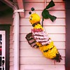 Buzzin' 'round the house (Dom Guillochon) Tags: house porch urban piñata humans people earth southerncalifornia time life outdoor existence reality dream buzzinround