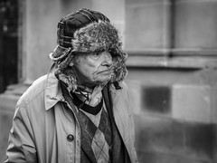 Wearing a Lifetime of Stories (Leanne Boulton) Tags: monochrome people depthoffield urban street candid portrait portraiture closeup streetphotography candidstreetphotography candidportrait streetportrait streetlife sociallandscape old aged elderly man male face facial expression look emotion feeling mood stubble fur hat winter tone texture detail bokeh naturallight outdoor light shade city scene human life living humanity society culture canon 5d 5dmarkiii 70mm character ef2470mmf28liiusm black white blackwhite bw mono blackandwhite glasgow scotland uk