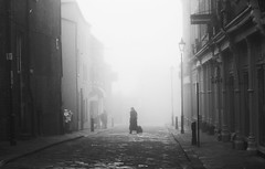 beauty and melancholy (matthewheptinstall) Tags: beauty melancholy street mono wakefield westyorkshire winter morning commute people streetphotography cold fog foggy mist figure blur