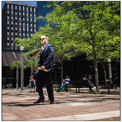 Business Lunch (or man with banana) (Britt Photographic) Tags: street urban humor streetphotography stpaul streetlife suit streetphoto streetcolor