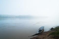 Boat on river (cedricmessemanne.com) Tags: morning travel peru fog river landscape boat amazon rainforest quiet peace jungle remote