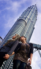 Malaysian girls posing in front of Petronas Twin Towers, Kuala Lumpur, Malaysia (Alex_Saurel) Tags: city travel portrait people color building architecture skyscraper pose asian asia day veiled hand veil outdoor muslim islam main group hijab photojournalism posing streetscene portraiture malaysia asie fullframe shoulder voile ville islamic 50mmf14 reportage malaisie lifestyles urbanisme  malasia portray halfbody  photoreport photoreportage 35mmprint planmoyen planamericain pleinformat malasia