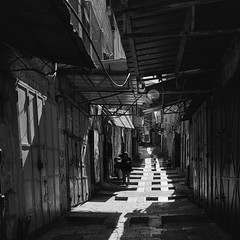 Old City Shadow Path (Warriorwriter) Tags: square israel alley shadows palestine westbank muslim jerusalem middleeast christian arab lane jewish conflict ilford israeli oldcity levant palestinian delta400
