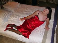 Heels in bed (Paula Satijn) Tags: red hot sexy stockings girl bed pumps legs silk tgirl transvestite heels slip satin gurl silky nightgown nightdress nightie