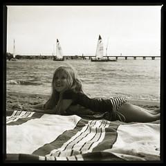 She prefers sand to a towel (LunaliteSBC) Tags: film beach melbourne slide bronica bayside filmcamera halfmoonbay ilford oldcamera bronicas2a ilforddeltapro100 blackandwhiteslide melbournesilvermine filmphotographyproject reversalprocessed
