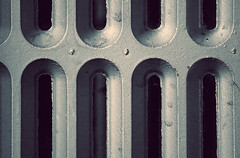 Let's warm this gallery up a bit (aquigabo!) Tags: montreal architecture heater metal iron warm monochrome abstract detail pattern canon eos aquigabo rebel dsrl t5i 700d 250mm lines curves home hot heat room