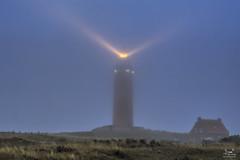 A beacon in the mist (dejongbram) Tags: lighthouse vuurtoren landscape bluehour nikon texel eierland light beam