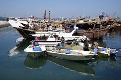 Souq Sharq Dhow Harbour (Colin McLurg) Tags: dhowharbour kuwait souqsharq colinmclurg fishermen fishingnets dhow boom kuwaitflag fishingboat