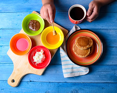 Rainbow Breakfast (Khaled A.K) Tags: blue red orange green colors yellow pancakes breakfast table photography hands nikon plate human honey syrup plates nutella pancake sa saudiarabia khaled ksa d7000 kashkari