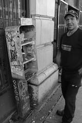 Man Explains Last Phone Booth in City - Matthew Humphrey BCIT Journalism Program (mattbhumphrey) Tags: phonebooth funnyman blacktshirt vancouverbc matthewhumphrey portraitphoto professorman