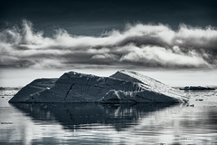 Imposing (claustral) Tags: wild bw cold ice water monochrome clouds arctic greenland iceberg 2012 ilulissat diskobay interestingness99 i500 explore20151026