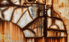 Sinuosity (Junkstock) Tags: old abstract color texture closeup wisconsin photography photo graphics rust paint graphic photos decay rusty textures photographs photograph rusted weathered abstraction aged peelingpaint distressed corrosion decayed colfax corroded rustyandcrusty oldstuff craquelure oldandbeautiful