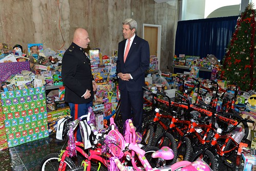 Secretary Kerry Listens to a Member of the U.S. Marine Corps at the Toys for Tots Ceremonial Presentation