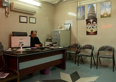 man working with a computer in a travel agency office with khomeini picture on the wall, Isfahan Province, Kashan, Iran (Eric Lafforgue) Tags: people paris male men industry horizontal work computer poster person photography office adult iran desk telephone muslim working middleeast indoors shia kuala kashan oneperson 40s occupation hennatattoo persiangulfstates khomeini  onemanonly  16676 colourimage 1people  iro isfahanprovince  westernasia