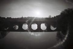 Gothic Flare (bigalid) Tags: film 35mm plastic hanimex 35se kodak bw400cn expired bw c41 2017 dumfries january lensflare flare sun river nith devorgilla bridge