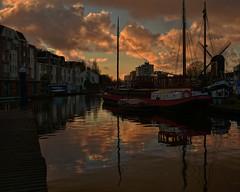 A golden moment in Leiden HDR (mark-marshall) Tags: leiden nikon18140mmf3556gedvrii nikon d500 bracketing hdr sunset goldenhour boats harbour canal netherlands holland windmill