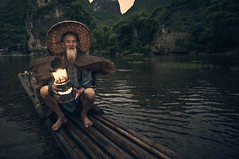 The lantern is ready... (Syahrel Azha Hashim) Tags: portrait lantern elite unique tokina shallow holiday chinese portraiture xingping ultrawideangle bird clouds 11mm local mountains river guilin traditional dof light bamboo detail iconic sunset conventional hat humaninterest birds dawn elder vacation d300s china bambooraft nikon naturallight moment colorful fishing cormorants travel syahrel handheld beard colors uwa getaway dramaticsky oldman fisherman