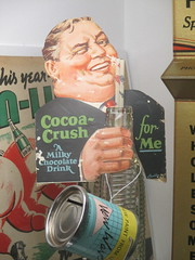 The Taste that Refreshes - Liquid Chocolate Cocoa Crush 0468 (Brechtbug) Tags: the taste that refreshes liquid chocolate cocoa crush cardboard standee ad billboard advertisement 01212017 new york city billboards poster shadows afternoon soda soft drink straw diet can bottle glass milky milk smiling winking man sidney greenstreet type guy 1930s straws sipping