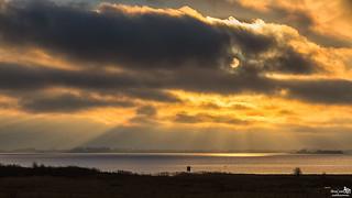 The sun shining through the cloud