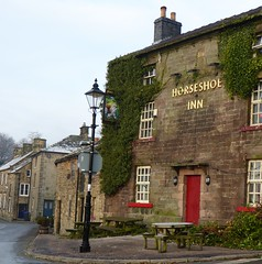 Horseshoe inn (lesleydugmore) Tags: village longnor peakdistrict england uk greatbritain europe pub street green lamp sign plant red windows door bench seat roof blue sky derbyshire