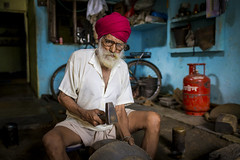 _MG_5782 (Dave Cavanagh Street) Tags: ujjain madhyapradesh india sikh workman hammer workshop turban craft glasses blue red gascanister travel travelphotography naturallight naturallightportrait portrait landscapeportrait