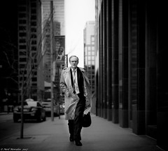 Follow the money. (Neil. Moralee) Tags: canadaneilmoraleenikond7100 neilmoralee moneu banker trade finance financial whitecollar crime man portrait street social comment reportage candid accountant accounts theft robber black white mono bandw bw monochrome nikon d7100 18300mmzoom neil moralee mature raincoat windy city skyline glasses briefcase work toronto canada business district fraud professional shirt tie dark