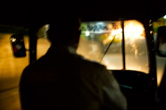 Racing At Night (alisdair jones) Tags: ef35mmf14lusm tuktuk driver night speed blur windscreen kandy srilanka