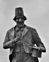 Tommy Cooper Statue, Caerphilly (bodythongs) Tags: red castle face hat television statue bronze laughing happy james tv nikon thomas hometown wand tommy fez cooper anthony birthplace done prop hopkins frederick magician castell caerphilly caerffili d5100 bodythongs