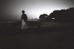 à une passante (asketoner) Tags: ocean sea woman white blur france beach silhouette night landscape rocks wide bretagne skirt locamariaquer