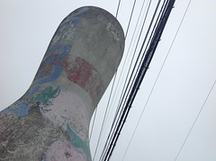 giant bowling pin and wires (Samm Bennett) Tags: sky up pen looking wires bowling