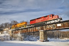 this is indian land (twurdemann) Tags: boxgirder bridge canadianpacific clouds cold cp6015 emdsd402 firstnation gardenriver graffiti huroncentralrailway landscape locomotive nikkor1685mm nikond300s pride protest railroad railway reserve rust schnee snow thisisindianland train winter