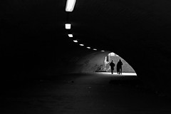 Go to the light (Daniel Nebreda Lucea) Tags: black white blanco negro people gente walk andar walking andando germany alemania german aleman tunnel tunel light luz dark oscuro darkness oscuridad shadow sombra shadows sombras monochrome monocromo city ciudad urban urbano canon 60d travel viajar atmosphere atmosfera lines lineas composition composicion capture captura life vida street passion award exit salida go ir out fuera inside dentro