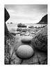 Elliptical (richieJ 11) Tags: porthnanven cornwall coast rocks round boulders beach granite mono blackandwhite longexposure